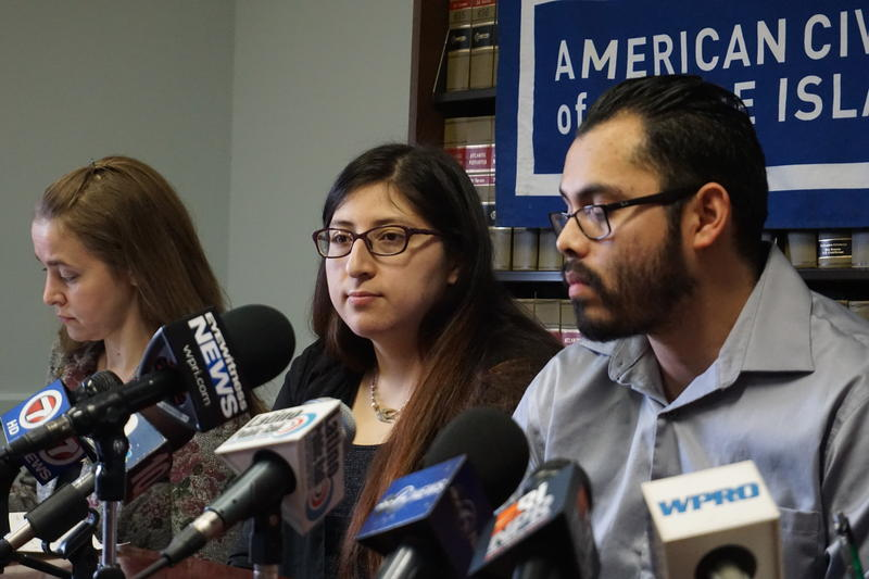 Lilian Calderon (center) sits with her husband Luis Gordillo and ACLU lawyer Adriana Lafaille during a press conference in Providence