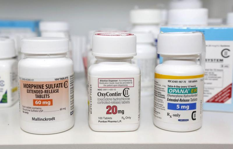Morphine Sulfate, OxyContin and Opana are displayed for a photograph in Carmichael, California, on Jan. 18, 2013.