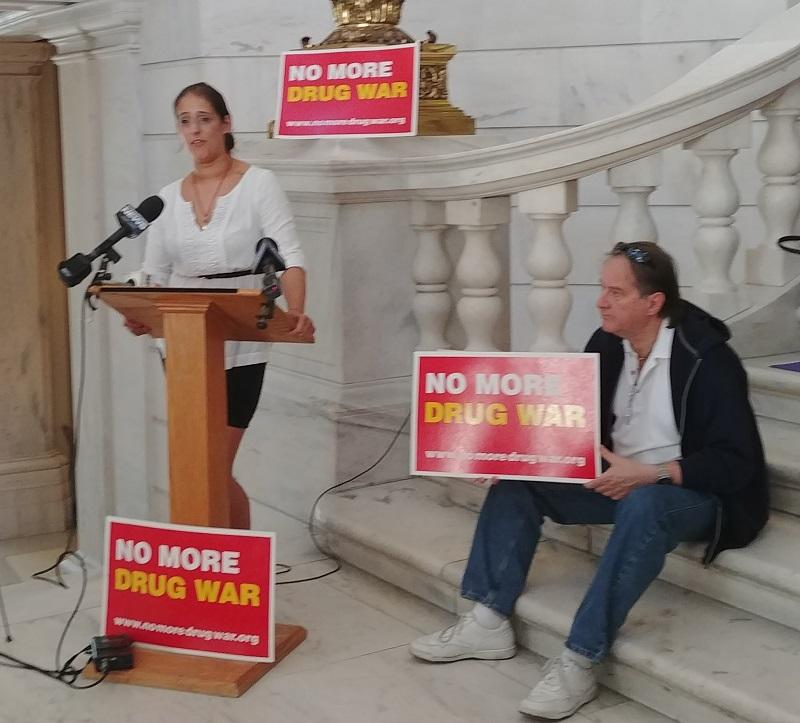 """RI Rep. Moira J. Walsh with opponents of Kristen's Law speaks at an """"anti-bill signing"""" event at the State House."""