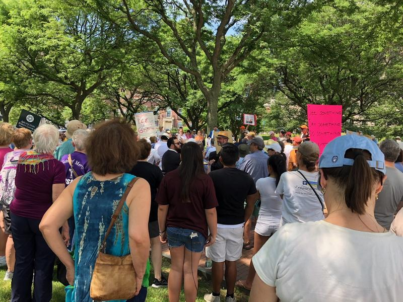 A gathering on the lawn of the RI Statehouse protesting new immigration policies.