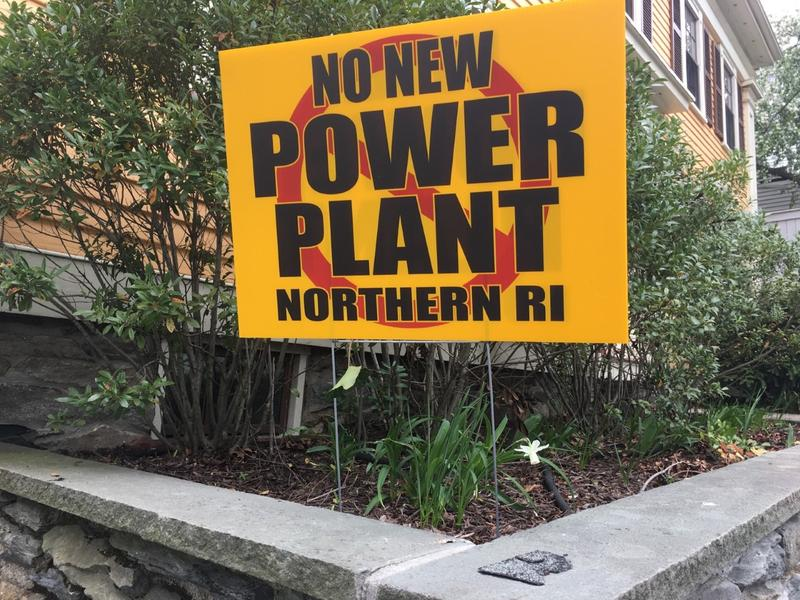 A sign in opposition to a natural-gas power plant proposed in Burrillville sits in the front lawn of a house in Providence.
