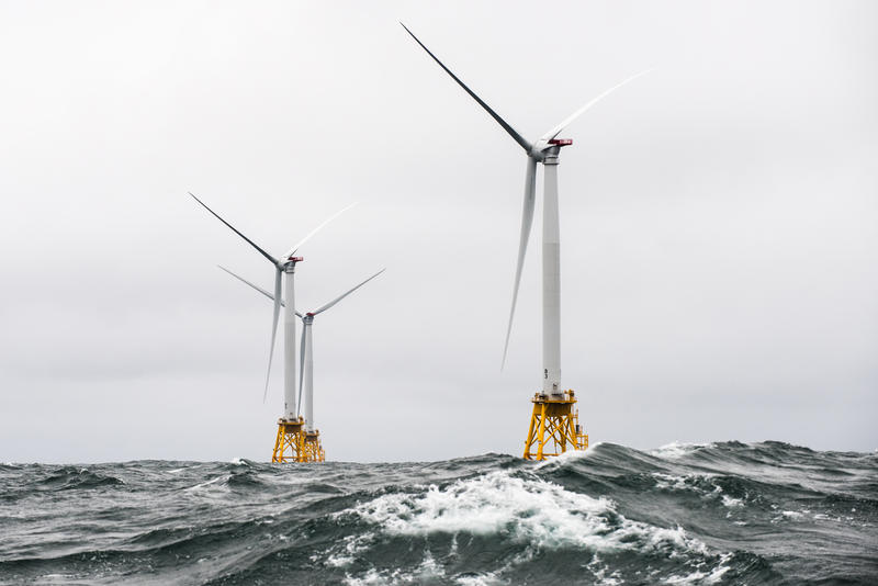 Wind turbines spin off the coast of Block Island. These turbines are part of the nation's first offshore wind farm, and New Bedford wants to be on the forefront of the up-and-coming offshore wind energy industry in Massachusetts.