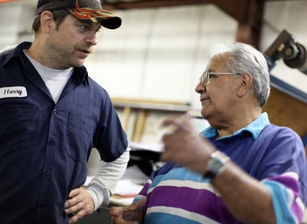 Maintenance Man Harry Collard and Machine Operator George Colon are seen talking during a recent weekday at Riverpointe Lace. Photo by Alex Nunes.