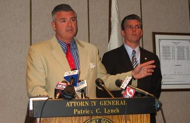 State Police Superintendent Brendan Doherty, left, and state Attorney General Patrick Lynch, right, pictured at a news conference yesterday. Photo by Megan Hall.