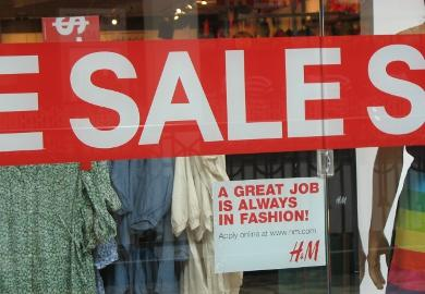 A sign seeking job applicants is seen at H&M at the Providence Place mall. Photo by Sarah Forman.
