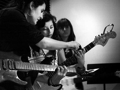 On guitar, Natalja Kent is instructing Stef Quatrucci. Courtesy Photo.