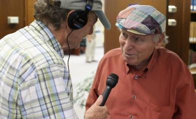 WRNI Morning Edition host Bob Seay, left, interviews Newport Jazz Festival founder George Wein. Photo by Alex Nunes.