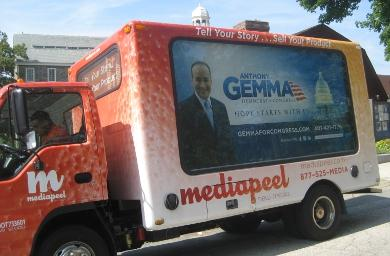 Democratic candidate Anthony Gemma's bus waits as he stumps in Pawtucket. Photo by Catherine Welch
