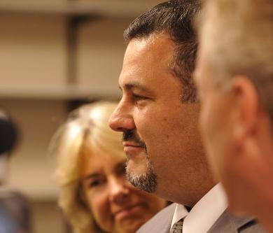 Woonsocket school Supt. Robert Gerardi is pictured at center. Photo by Louis Oppenheimer.