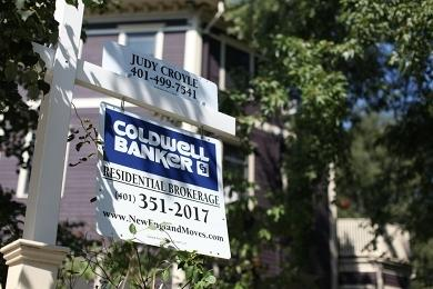 A real estate sign is seen in Providence's West End. Photo by Alex Nunes.