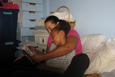 Toni Talbot reads to her nine-year-old daughter Nicoi at a family shelter in Warwick. Photo by Flo Jonic.