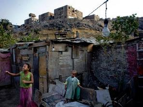 Children play near their home in the Duweika area of Cairo. A growing majority of Egypt's population is scraping by on less than $100 a month and can only afford to live in shantytowns and tents. Holly Pickett for NPR.