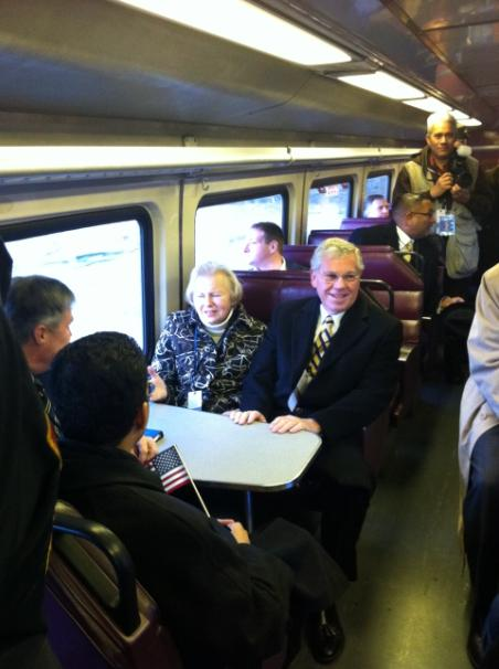 Governor Carcieri and his wife Suzanne Carcieri ride the MBTA rail service from Providence to T.F. Green Airport in Warwick this morning. Photo courtesy of Rhode Island Department of Transportation.