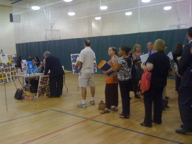Teachers line-up in the gymnasium for potential work.