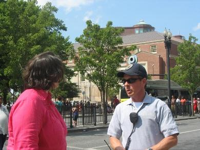 Probation officer Heidi DuPerry and Kennedy Plaza park ranger Dane Shillan take a look around the bus terminal