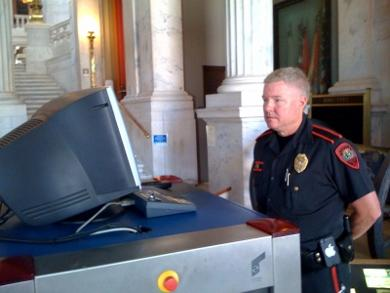 Capitol Police officer Reggie Packer staffs the security station at the entrance to the Statehouse.