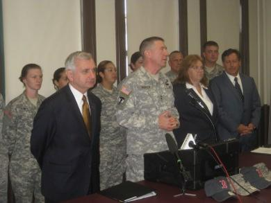 U.S. Senator Jack Reed, officials from the National Guard and Red Sox chairman Tom Werner announce the bill.