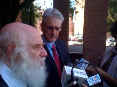 Robert Mann (left) and John Leidecker talk with reporters after conviction of cyber-stalking.