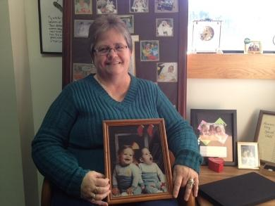 Dawn Wardyga holds a photo of her twins, born on Valentine's Day 26 years ago. The younger twin, Jason, died as a result of injuries in the hospital.