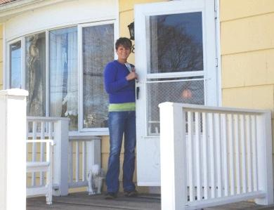 Tinamarie Turano stands outside her home in Westerly.