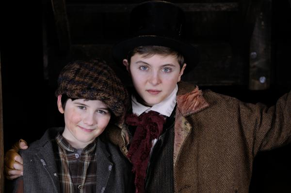 Phineas Peters as Oliver and Noah Parets as Artful Dodger in Trinity Rep's Oliver! by Lionel Bart, based on Oliver Twist by Charles Dickens. Directed by Richard and Sharon Jenkins, set design by Eugene Lee, costume design by WIlliam Lane.