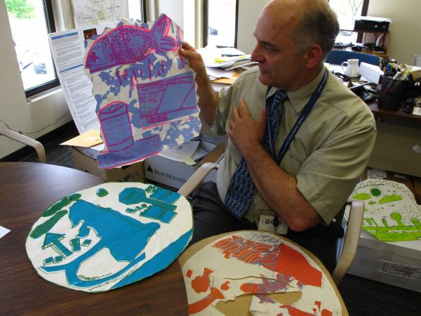 Bob Vanderslice, the Rhode Island Health Department's team lead of the Healthy Homes and Environment initiative, still keeps the first silk screens about Mashapaug Pond created by children.