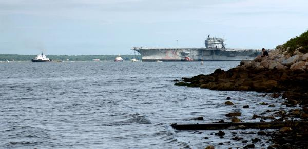 The ex-USS Saratoga was pulled out of the Newport Naval Station Thursday morning. It's headed to Texas.