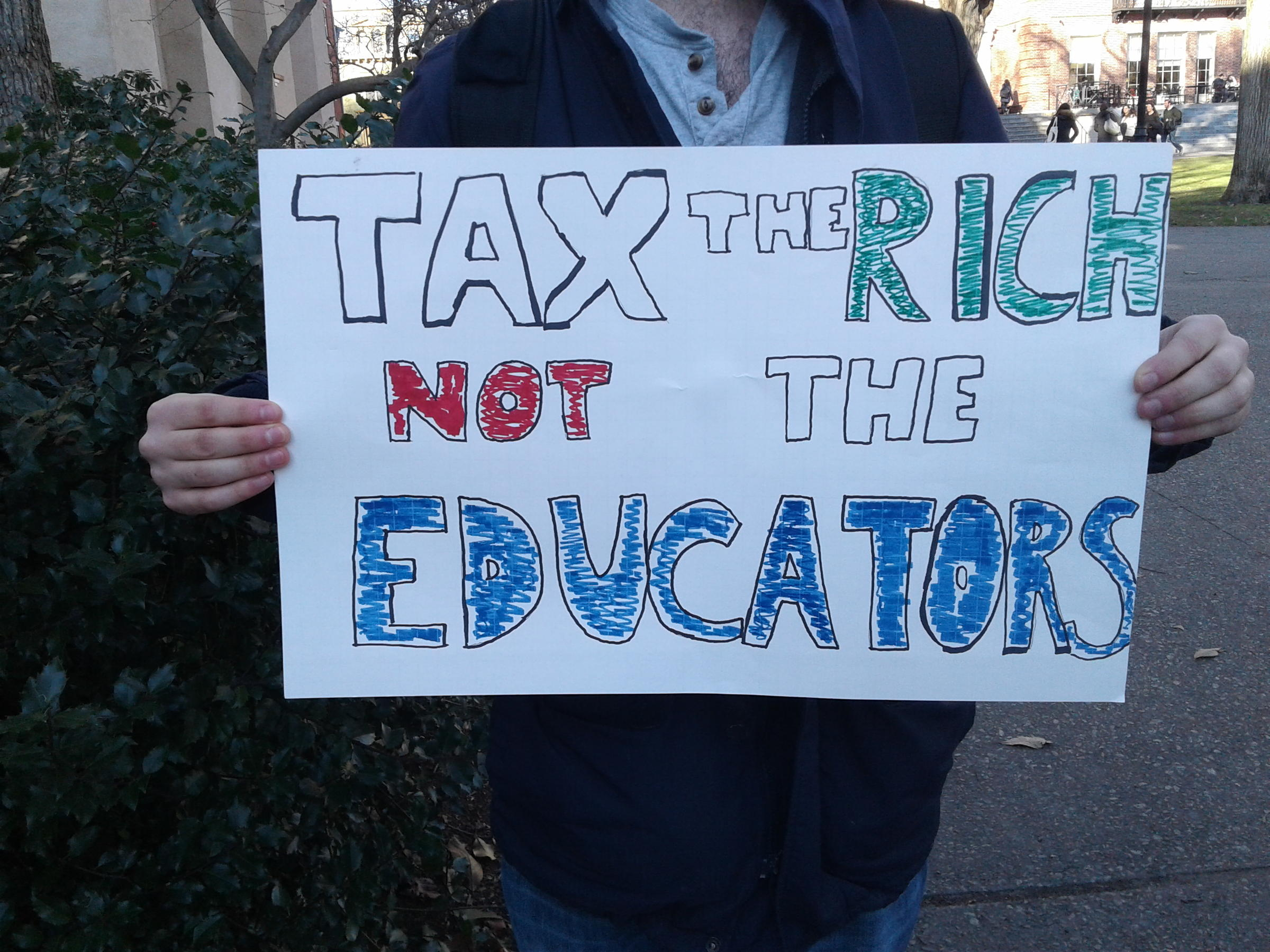 I may have to drop out: Graduate students take on tax bill