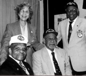 Dr. Moore with three Tuskegee Airmen featured on her show.