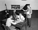 Temple University students at work in the WRTI studios, October 14, 1955. Photo courtesy of Temple Urban Archives.