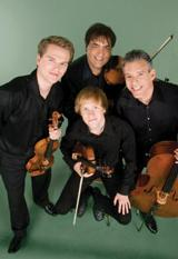 Turtle Island Quartet. Founder David Balakrishnan is pictured at top, in center.