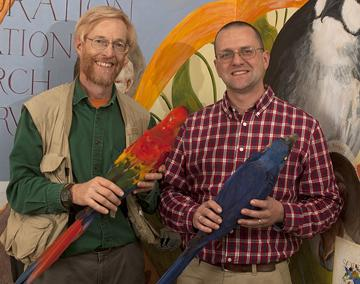 The Academy at 200: The Nature of Discovery features some of the museum's amazing collections like these macaws held by Academy ornithologists Doug Wechsler (left) and Dr. Nate Rice.
