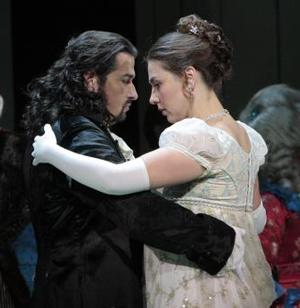 Baritone Dalibor Jenis is the title character and soprano Oksana Dyka is the young woman who sends him a love letter in LA Opera's production of Tchaikovsky's Eugene Onegin.