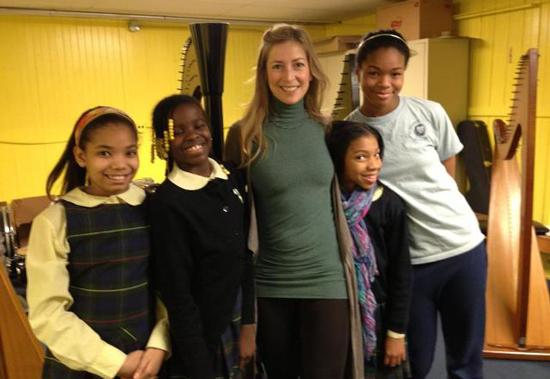Elizabeth Hainen visits harp students at Philadelphia's St. Francis de Sales school.