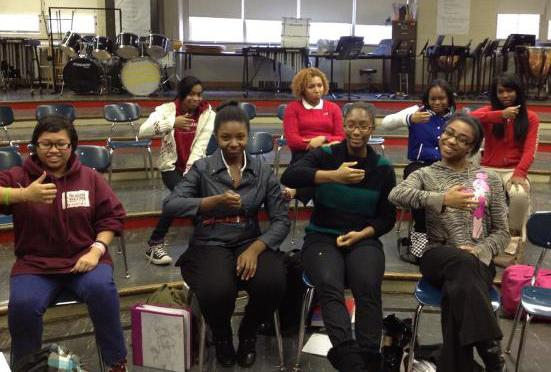 Students at Philadelphia HIgh School for Girls displaying harp hand positions.