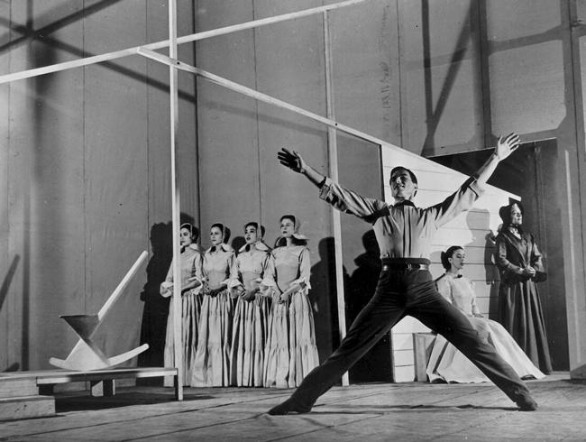 Erick Hawkins in the first production of Appalachian Spring, 1944. In the background, left to right: the four Followers, Martha Graham, May O'Donnell