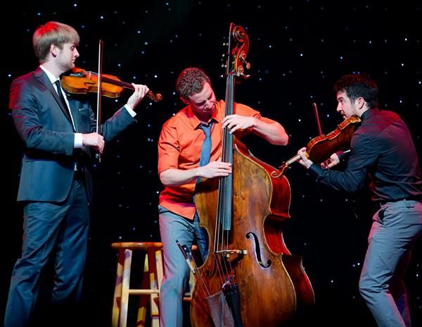 The musicians of Time for Three are (left to right)  Zach De Pue, Ranaan Meyer, and Nick Kendall.
