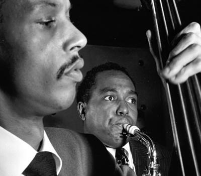 Jazz bassist Tommy Potter with Charlie Byrd in NYC in the late 1940s.