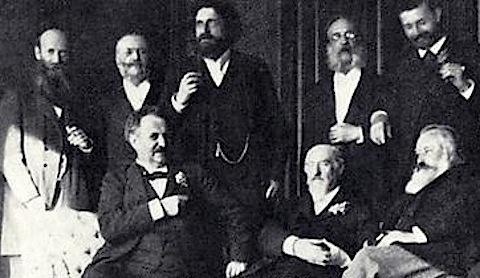 Standing: Ignaz Brüll, Anton Door, Josef Gänsbacher, Julius Epstein (Brüll's piano teacher), Robert Hausmann. Sitting: Gustav Walter, Eduard Hanslick, Johannes Brahms.