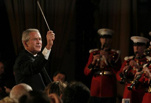 President George W. Bush led the U.S. Marine Corps Band at the White House Correspondents Association Dinner in 2008.
