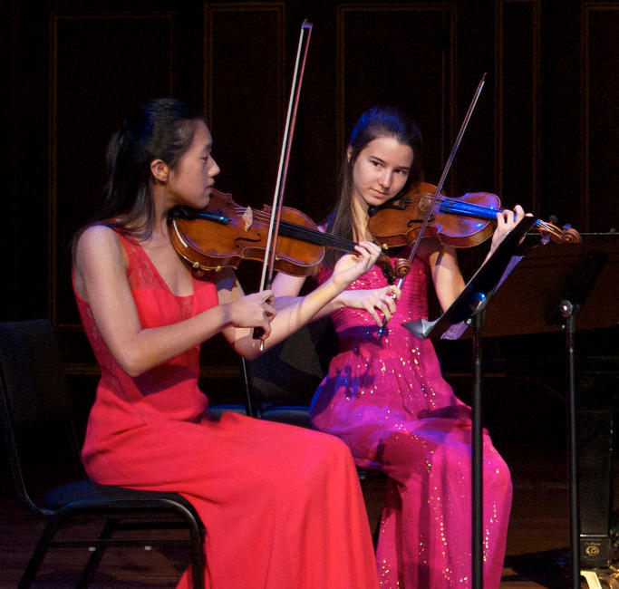 Violinists Beatrice Hsieh and Carolyn Semes from Settlement Music School's Snitzer String Quartet perfoming on FROM THE TOP.