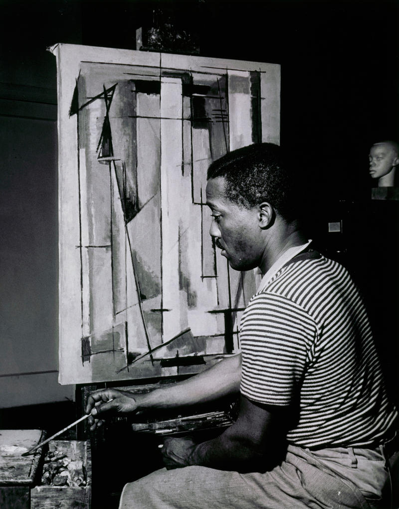 Norman Lewis working on Composition I, 1945