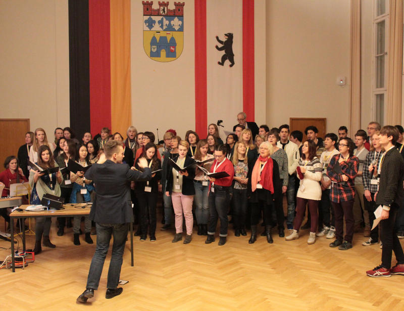 "Chamber Singers of Haverford and Bryn Mawr Colleges sing with the ""Coming Together Choir"" in Berlin."