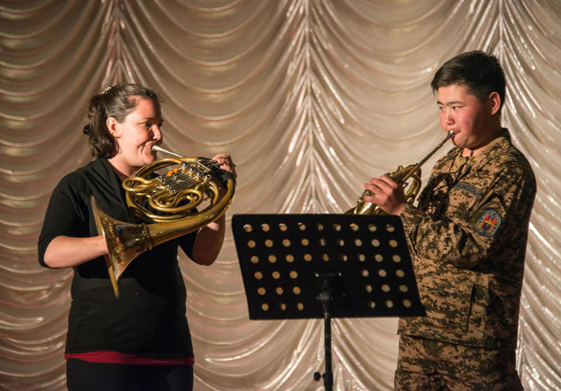 Jennifer Montone works with a student in a masterclass at the National Defense University in Mongolia.