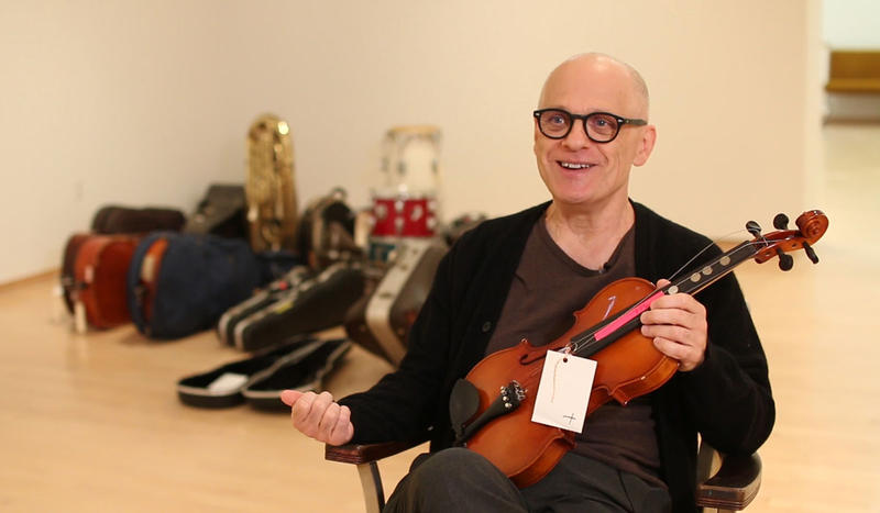 """Composer David Lang with wounded instruments featured in his """"Symphony for a Broken Orchestra."""""""