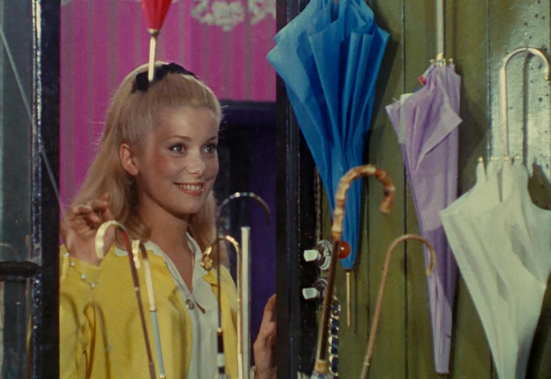 The Umbrellas of Cherbourg, from 1964, has a theme song that one of our hosts adores.