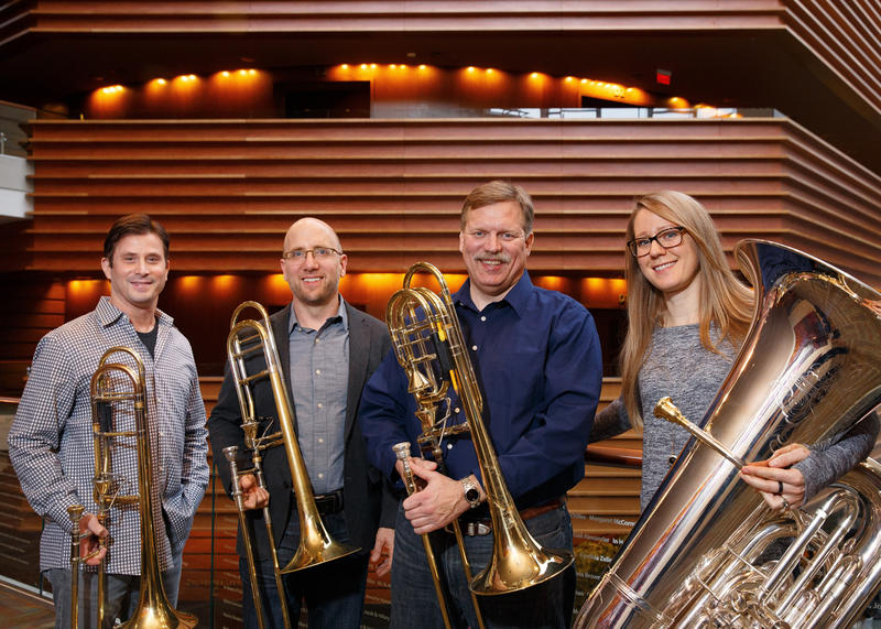 (Left to right) Philadelphia Orchestra musicians: Nitzan Haroz, principal trombone; Matthew Vaughn, co-principal trombone; Blair Bollinger, bass trombone; Carol Jantsch, principal tuba in the lobby of the Kimmel Center