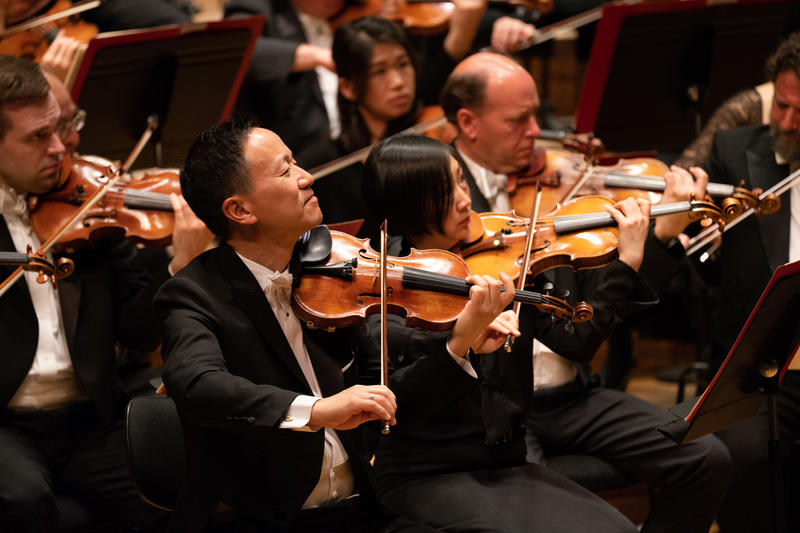 Concertmaster David Kim and fellow musicians performing at Tel Aviv's Bronfman Auditorium