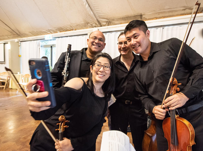 The quartet takes a selfie!