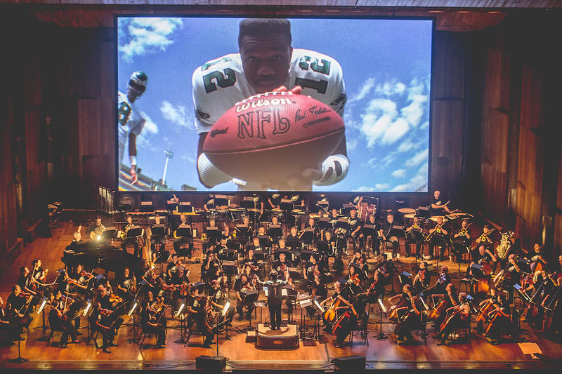 The Philadelphia Orchestra playing the score for NFL Films' A Championship Season at the Mann Center